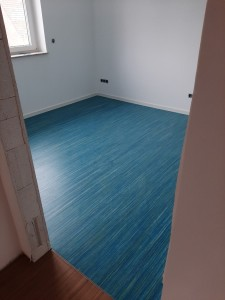 Bodenbelagsarbeiten: hier Linoleum-Verlegung
